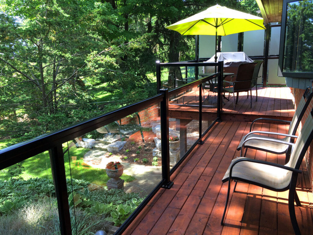 Renaissance Rail aluminum and glass railings, with acid-etched privacy panels, black, on a wood deck in Georgetown, ON