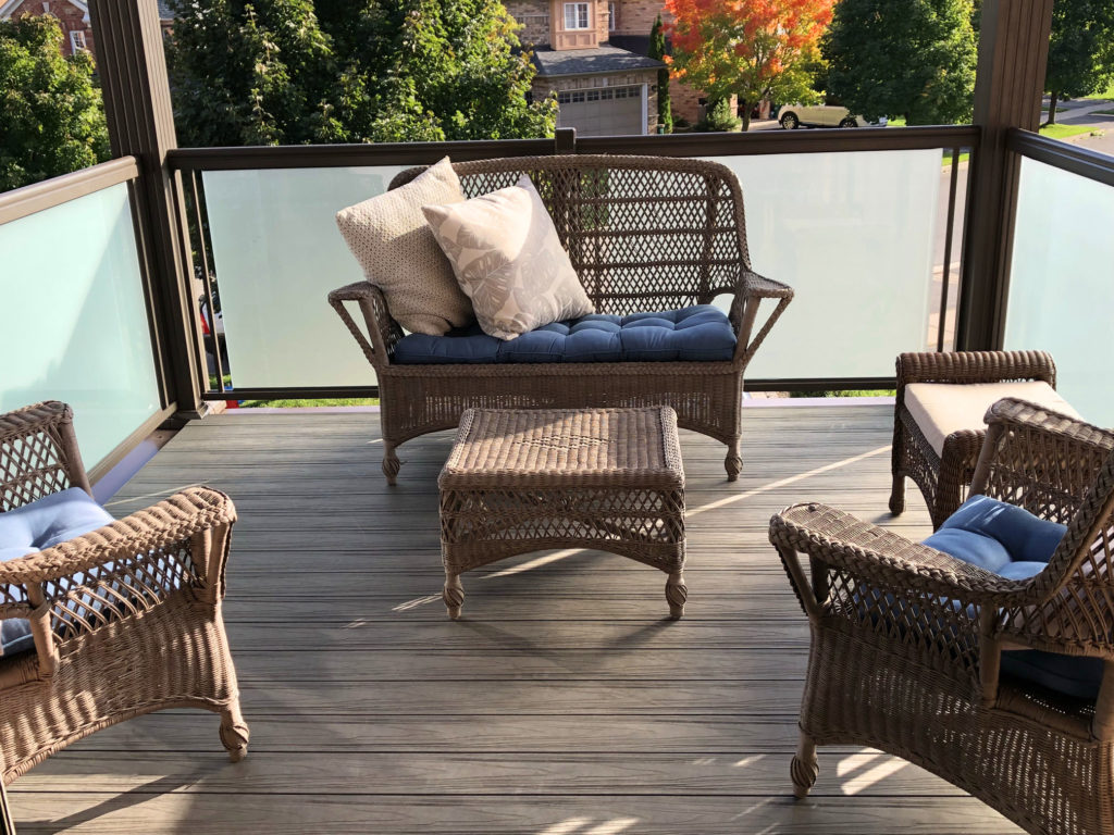 Renaissance Rail aluminum and frosted glass railings, brown, on a second floor balcony deck in Georgetown, ON