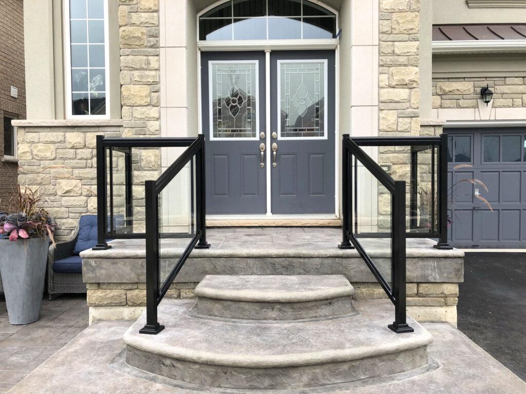 Renaissance Rail aluminum and glass railings, black, on a front entrance in Burlington ON