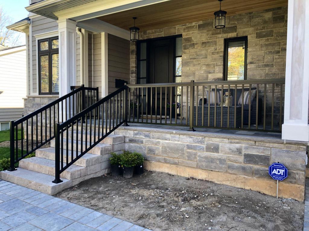 Renaissance Rail aluminum spindle railings, black, on a stone front entrance in Burlington, ON