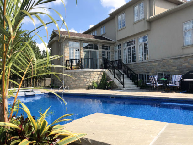 Renaissance Rail aluminum curved spindle railings, black, on a backyard pool patio in Ancaster, ON