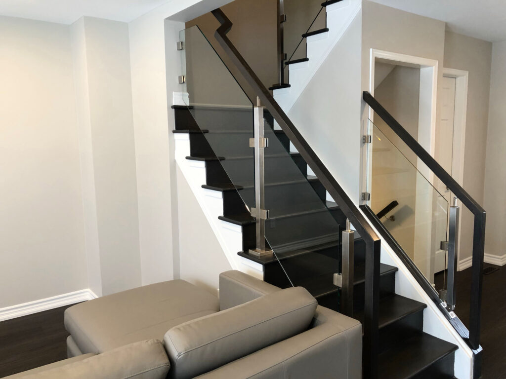 Renaissance Rail stainless steel and glass railings, square posts, oak handrails, on interior stairs in Grimsby, ON