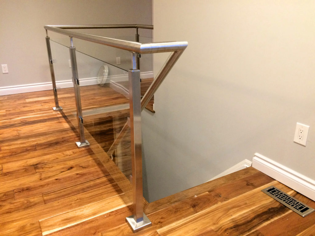 Renaissance Rail stainless steel and glass railings, square posts, around interior stairs in Georgetown, ON