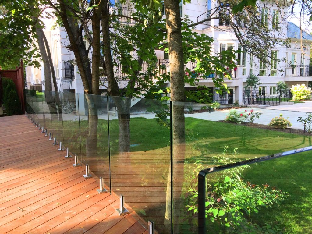 Renaissance Rail stainless steel and glass railings, spigot posts, on an Ipe wood deck in Toronto, ON