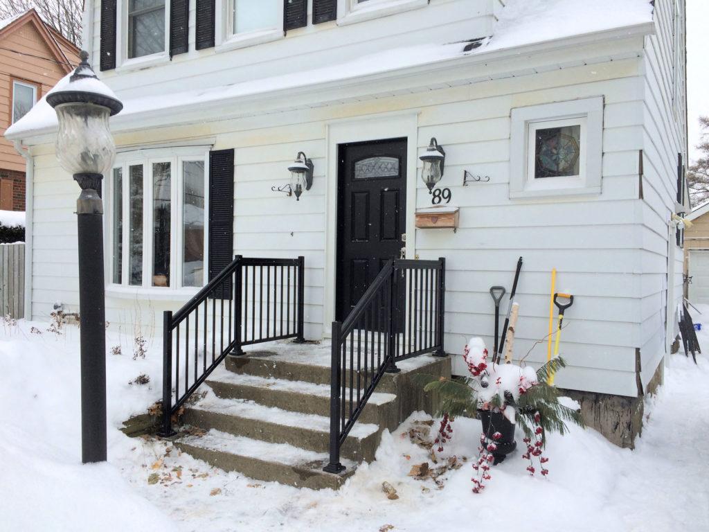 Renaissance Rail aluminum spindle railings, black, on a concrete front porch in Hamilton, ON