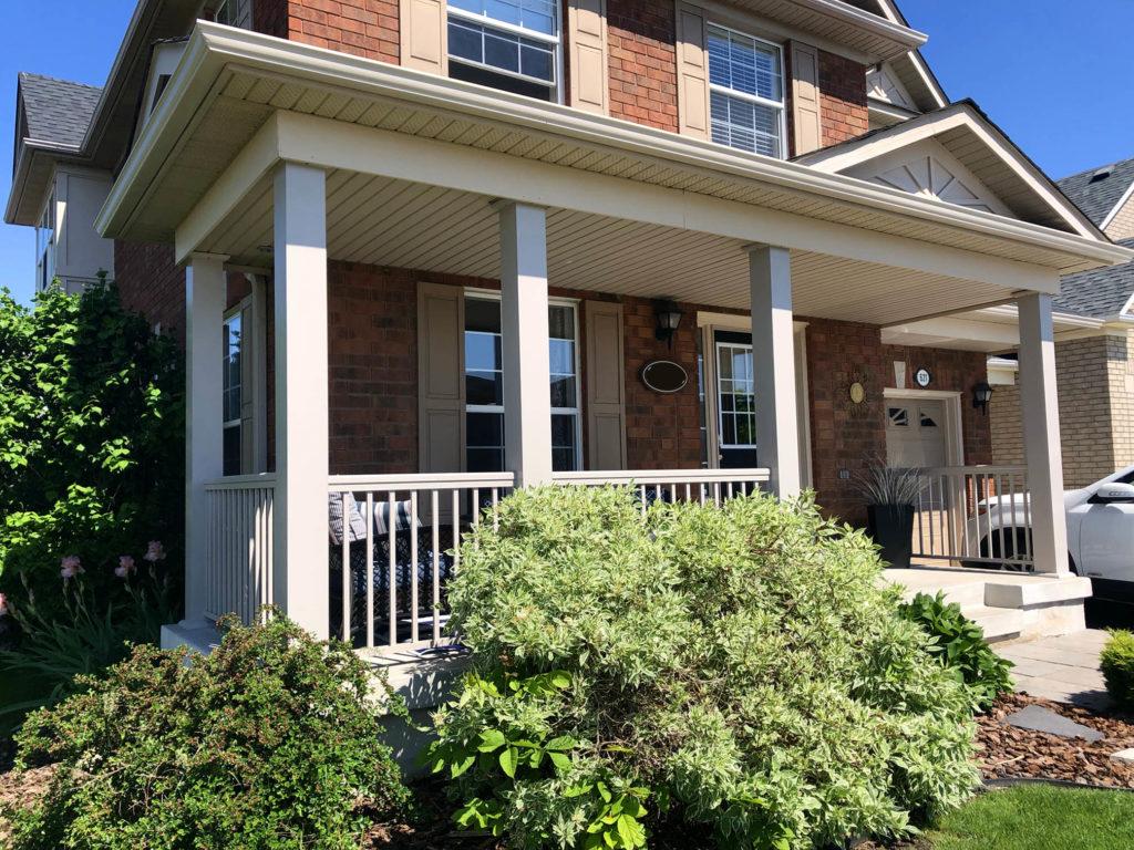 Renaissance Rail aluminum spindle railings and aluminum columns, warm beige, on a concrete front porch in Milton, ON