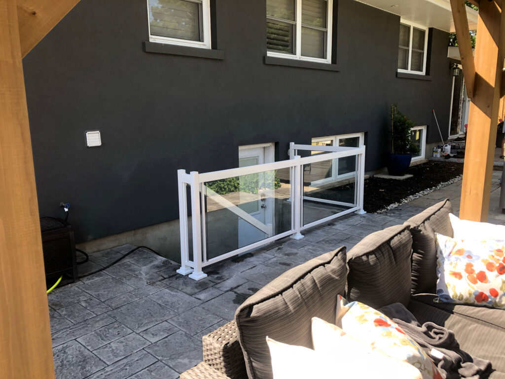 Renaissance Rail aluminum and glass railings, white, on a basement entrance in Grimsby, ON