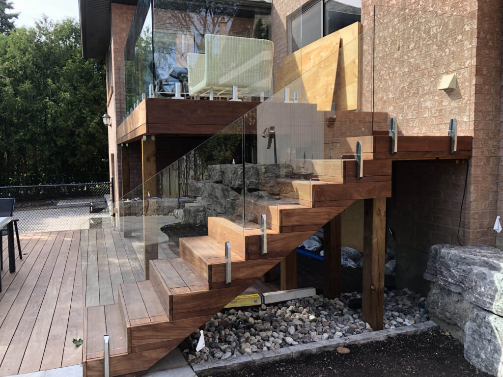 Renaissance Rail stainless steel and topless glass railings, on a deck in Toronto, ON