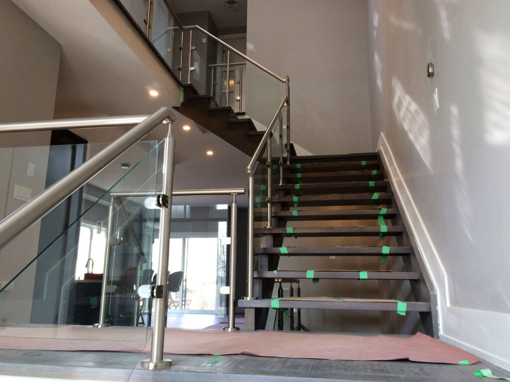 Renaissance Rail stainless steel and glass railings, on interior stairs in Mississauga, ON