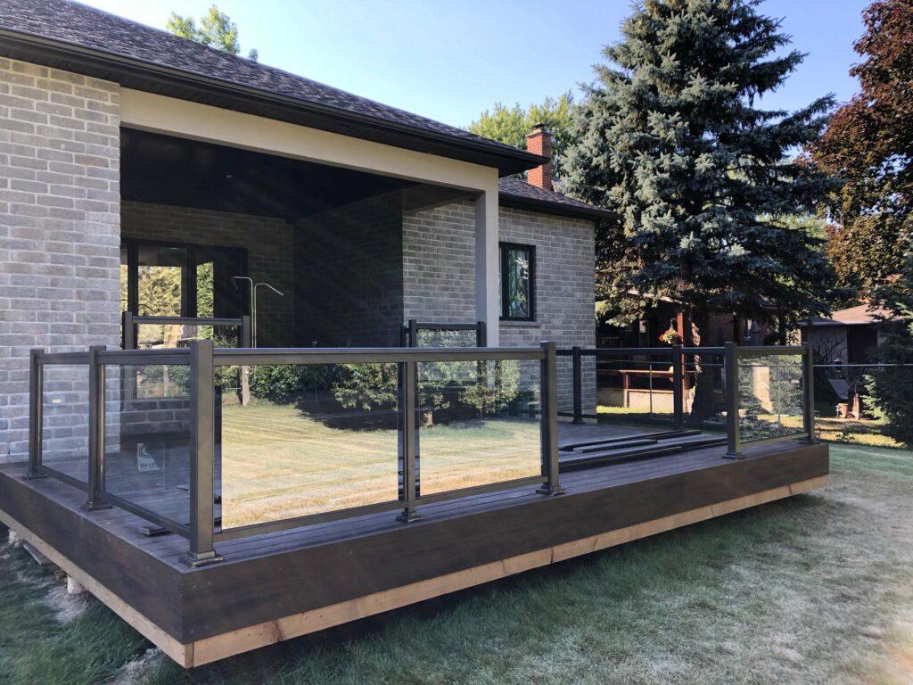 Renaissance Rail aluminum and glass railings, brown, on a backyard deck in Hamilton, ON