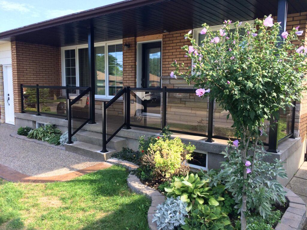 Renaissance Rail aluminum and glass railings, black with bronze-tint glass panels, on a front porch in Hamilton, ON