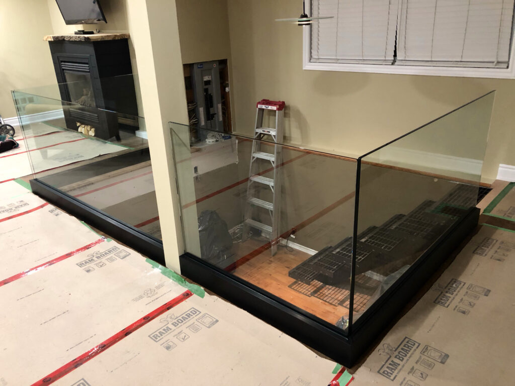 Renaissance Rail stainless steel and glass railings, black base shoe, in Grimsby, ON