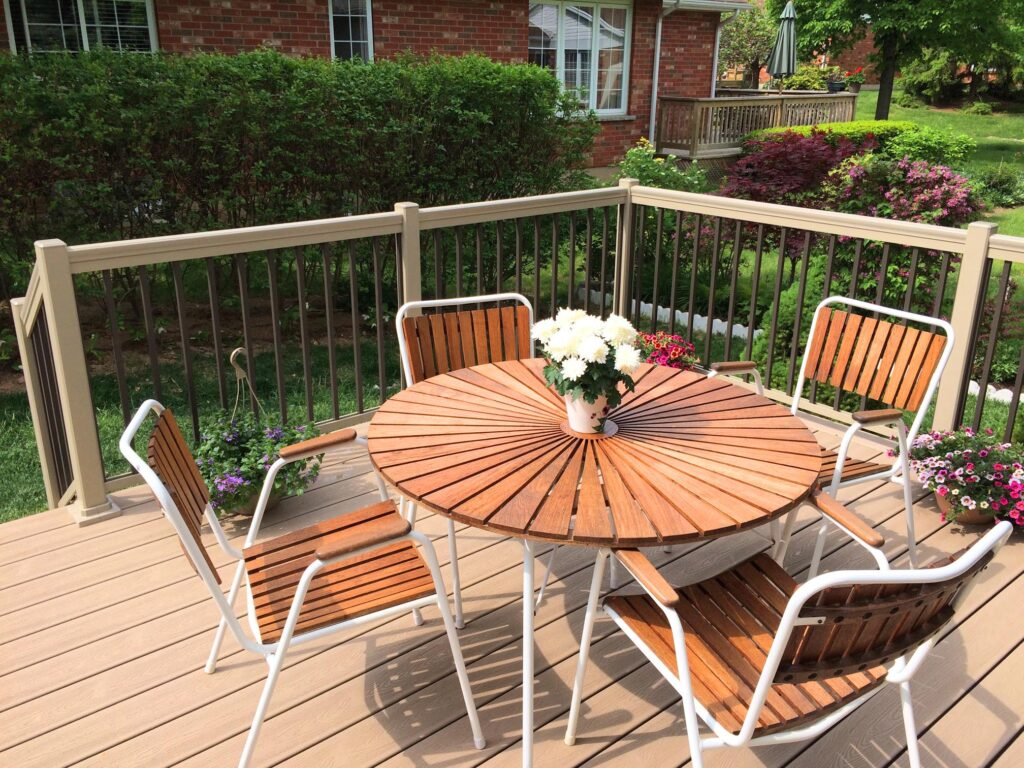 Renaissance Rail aluminum railings, clay and brown, on a deck in Grimsby, ON