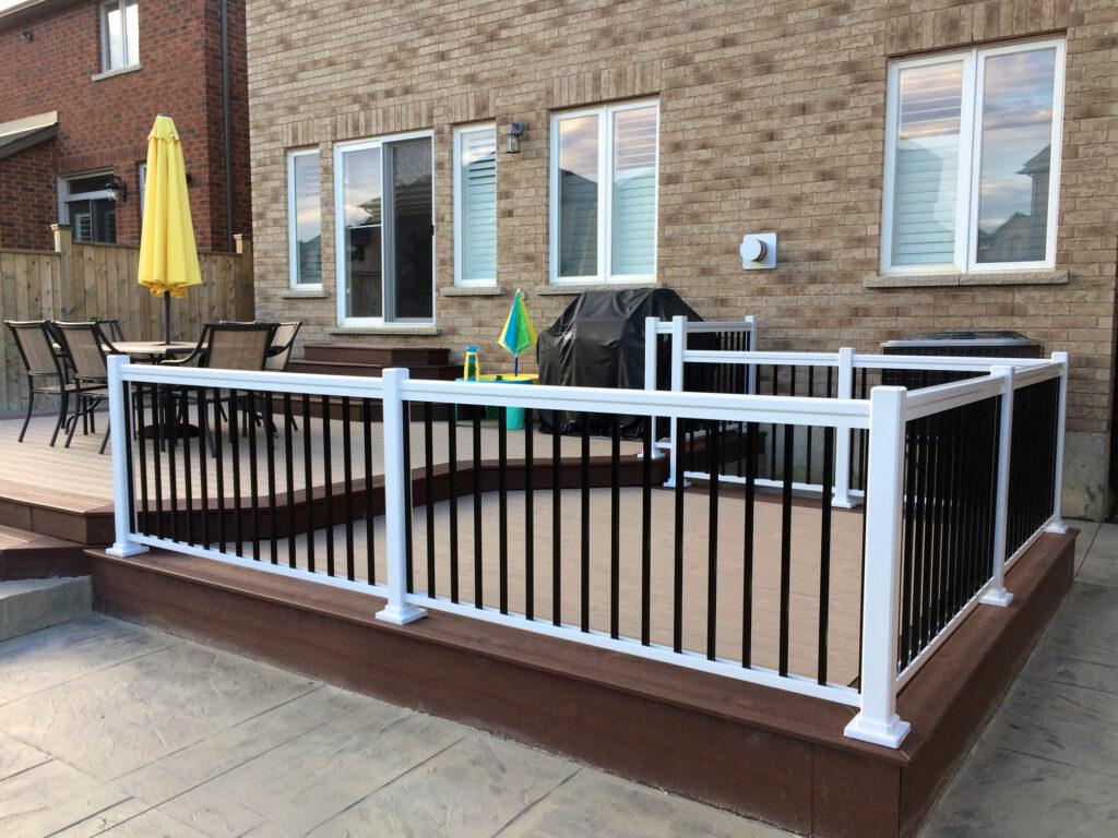 Renaissance Rail aluminum railings, black and white, on a deck in Hamilton, ON