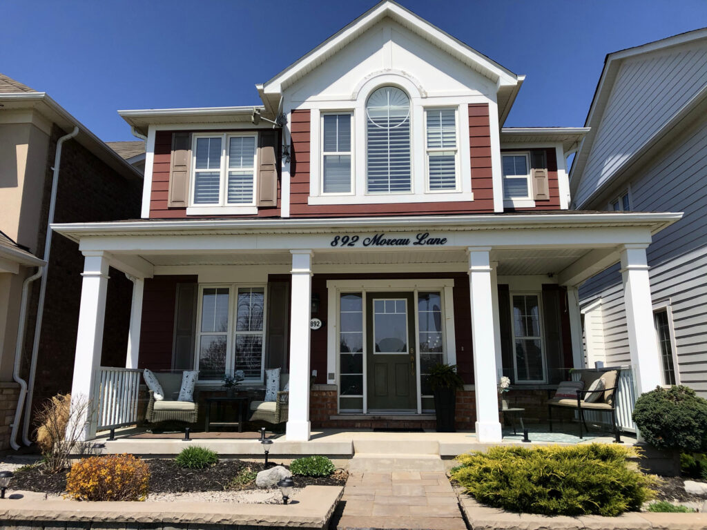 Renaissance Rail stainless steel and topless glass railings, black, on a home in Milton, ON