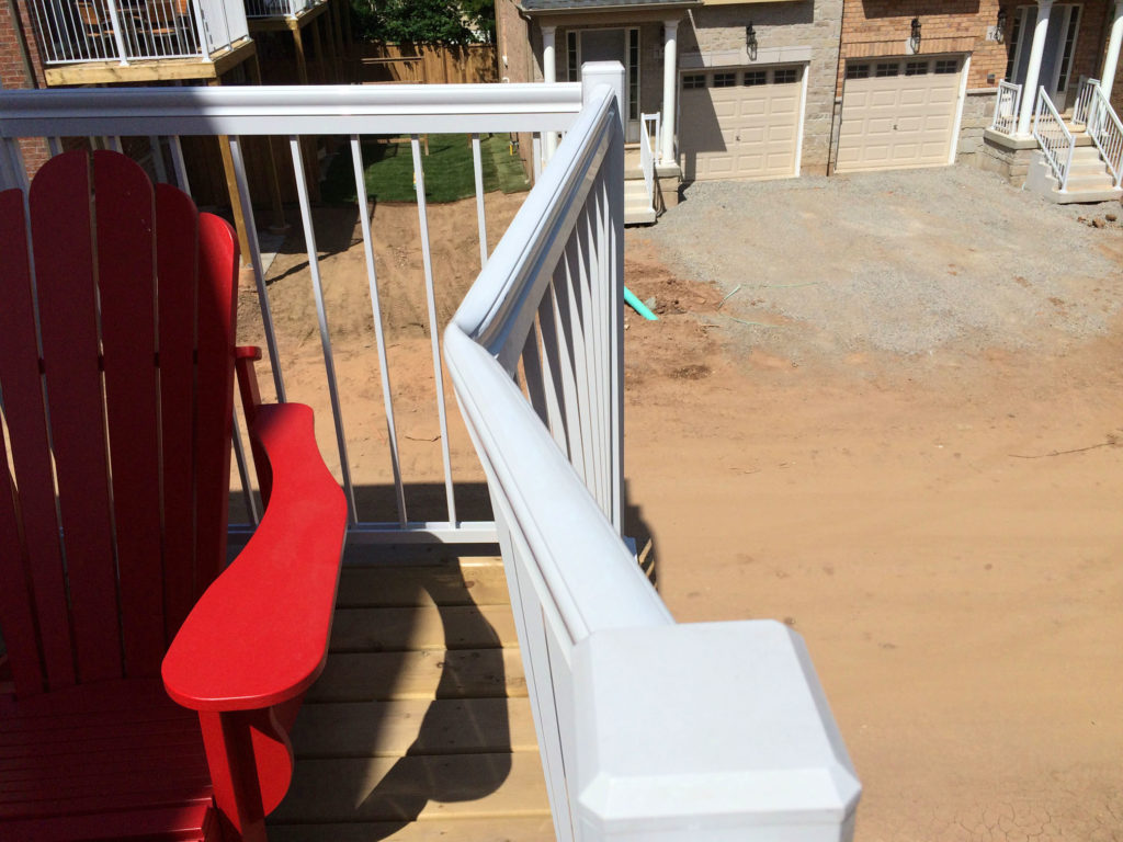 Renaissance Rail aluminum spindle balcony railings, white, withstand damage from falling hydro pole in Burlington, ON